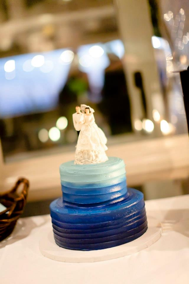 The cake topper originally from Lisa's grandmother's wedding atop the gorgeous ombre blue cake.